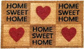 Beautiful Home sweet home peach color coir doormat with hearts. Isolated on a White Background royalty free stock photos