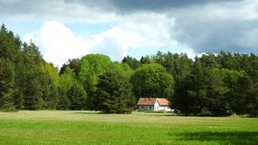 Home, field, trees and beautiful cloudy sky, Lithuania stock photo