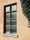 Home window and plant, Lithuania. Beautiful home wall and window and green creeper in Sveksna town royalty free stock photo