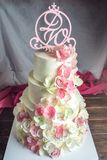 Beautiful home wedding four-tiered cake decorated with pink and green fondant handmade Stock Images