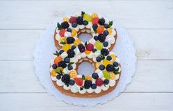 Free Beautiful Homemade Cake In The Shape Of The Number Eight With Natural Berries Royalty Free Stock Image - 136092376