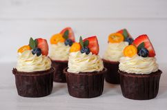 Beautiful homemade cupcakes with strawberries on white table stock photos