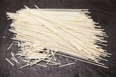 Beautiful homemade Italian pasta spaghetti from durum wheat on stone background, closeup.  Stock Photography