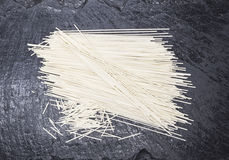 Beautiful homemade Italian pasta spaghetti from durum wheat on stone background, closeup.  Stock Images