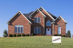Beautiful Homes Foreclosure. Beautiful  foreclosed home against a beautiful blue sky, located in affluent neighborhood Stock Photography