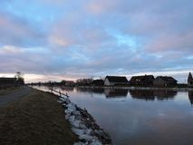 Homes and river Minija in winter, Lithuania Stock Photography