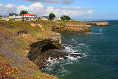 Beautiful homes are to be seen on the prestigeous Cliff Drive in Santa Cruz. The rocky and precipitous shoreline cliffs have some of the nicest and pricey real Royalty Free Stock Image