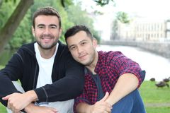 Beautiful homosexual couple in the park.  stock photography