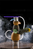 Beautiful hookah. With pineapple and melon is on the table royalty free stock images
