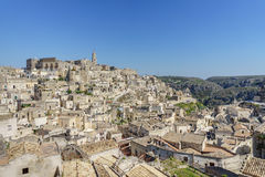 Beautiful horizon of ancient ghost town of Matera Sassi di Mate. Ra in beautiful bright sun shine with blue sky, south Italy Royalty Free Stock Image