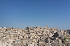 Beautiful horizon of ancient ghost town of Matera Sassi di Mate. Ra in beautiful bright sun shine with blue sky, south Italy Stock Photo