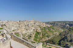 Beautiful horizon view of ancient ghost town of Matera Sassi di. Matera in beautiful bright sun shine with blue sky, south Italy Royalty Free Stock Photography