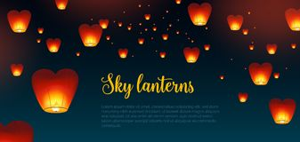 Beautiful horizontal background with Kongming Chinese lanterns. And place for text. Backdrop with traditional asian festival airborne decorations in dark night Royalty Free Stock Photography