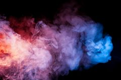 Beautiful horizontal column of smoke in the neon bright light of blue pink and orange on a black background exhaled out of the stock illustration