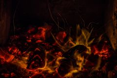 A beautiful horizontal texture of a burning fire on a black background with sparks. Is in the photo Stock Photos