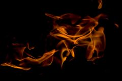 A beautiful horizontal texture of a burning fire on a black background with sparks. Is in the photo Stock Image