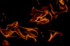 A beautiful horizontal texture of a burning fire on a black background with sparks. Is in the photo Royalty Free Stock Photography