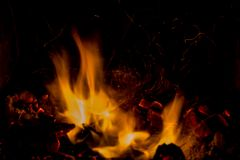 A beautiful horizontal texture of a burning fire on a black background with sparks. Is in the photo Royalty Free Stock Images