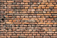 A beautiful horizontal texture of part of a old crashed brick wall in brown hue. Is on the photo royalty free stock photo