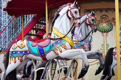 Beautiful horse Christmas carousel in a holiday park. Two horses Royalty Free Stock Images