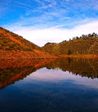 Beautiful Horsetooth Reservoir in Colorado front range mountains. Beautiful calm day in November with red rocks, rouch terrain, smooth water, blue sky Royalty Free Stock Photography