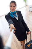 Beautiful hostess in airport with mobile phone. Stock Photography