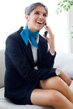 Beautiful hostess in airport with mobile phone. Stock Image
