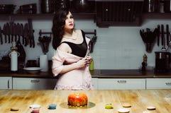 Beautiful hostess and cakes Stock Photo