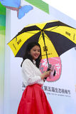 Beautiful hostess chen preside over the opening ceremony. in the rain hold umbrella Royalty Free Stock Images