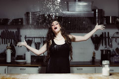 Beautiful hostess drops flour up stock images