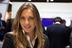 Beautiful hostess at Smau exhibition in Milan, Italy. MILAN, ITALY - OCTOBER 23: Beautiful hostess at Smau, international exhibition of information Royalty Free Stock Photo