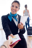 Beautiful hostess working in airport. Stock Images