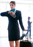 Beautiful hostess working in airport. Royalty Free Stock Image