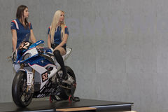 Beautiful hostesses present motorcycle BMW S 1000 RR
