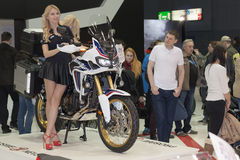 Beautiful hostesses present motorcycle Honda CRF1000L Africa Twi