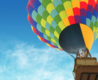 Beautiful Hot Air Balloon against a deep blue sky. Royalty Free Stock Image