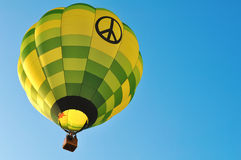 Beautiful hot air balloon - peace and love symbol. Beautiful scene with hot air balloon in the sky Stock Photos