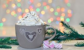 Beautiful drink with cream and marshmallows. Beautiful hot drink cocoa ,coffee with cream and marshmallow near Christmas tree Stock Photos