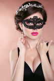Beautiful hot girl model with mask. Makeup. Hairstyle. Jewelry. Stock Photo