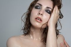 Beautiful hot satisfied nude woman with smoky-eyes make-up Royalty Free Stock Photos