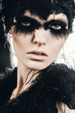 Beautiful hot woman with black feathers on eyes Royalty Free Stock Photography