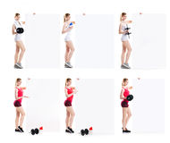 Beautiful hot young sporty woman with dumbbell standing nearby the billboard. Stock Image