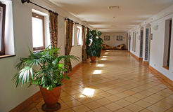 Beautiful hotel corridor with tile floor Royalty Free Stock Images