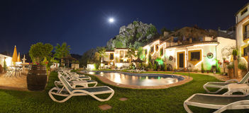 Beautiful hotel in mountain village at night. Royalty Free Stock Photo