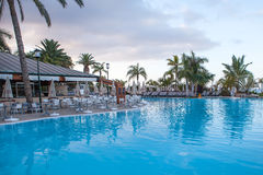 Beautiful hotel swimming pool befor sunrise Stock Images