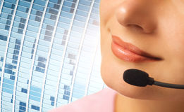 Beautiful hotline operator. With headset Royalty Free Stock Photo