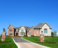 Beautiful house. Grass and blue sky Stock Images