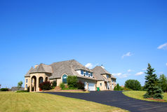 Beautiful house. Blue sky, clouds and grass Stock Photos