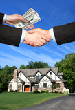 Beautiful house. Hands and money Stock Images