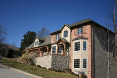 Beautiful house. A beautiful home featuring cultured stone and brick royalty free stock photo